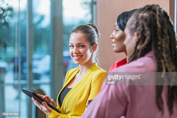Multi-racial business people, focus on Caucasian woman