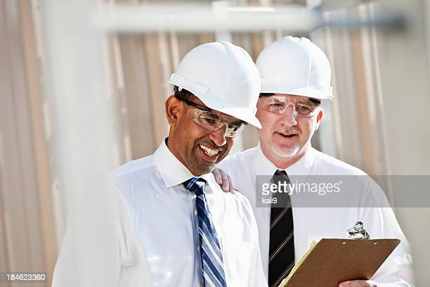 Multiracial engineers at industrial site
