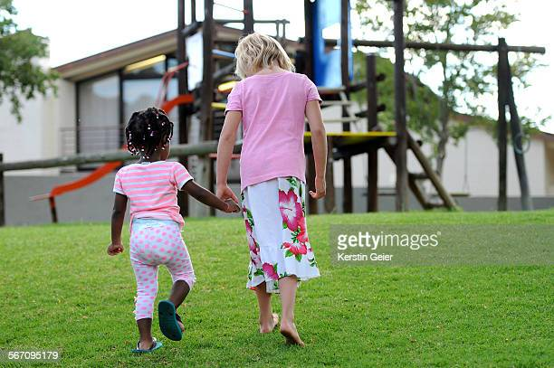 Multiracial girls in playground. Windhoek, Namibia.