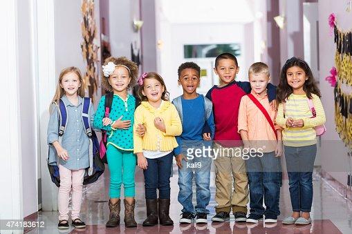 Multiracial group of children in preschool hallway