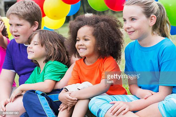 Multiracial group of children in summer camp