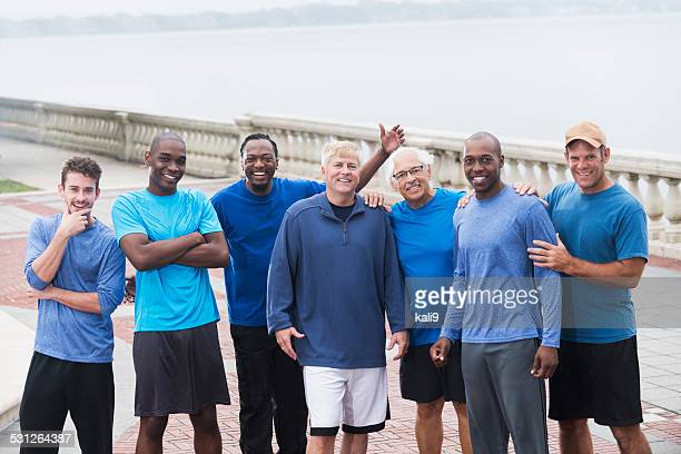 Multiracial group of men wearing blue shirts