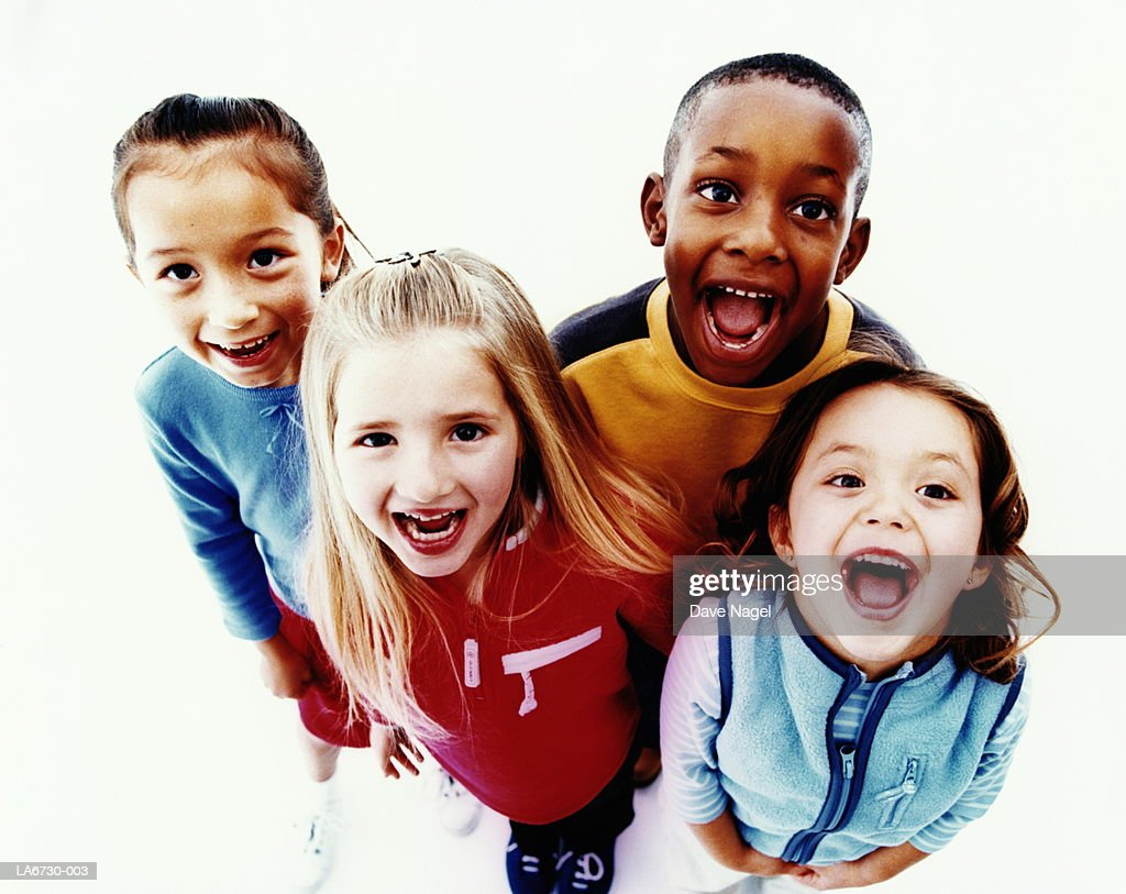 Multiracial group (7-9) smiling, portrait, elevated view : Stock Photo