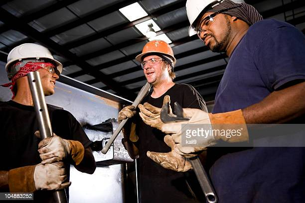 Multiracial industrial workers working in factory