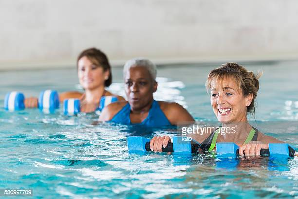 Multiracial mature women in water aerobics class