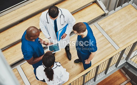 Multiracial medical team having a discussion : Stock Photo