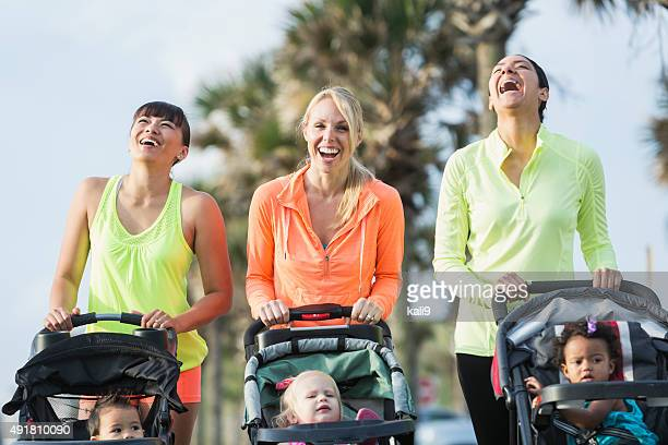 Multi-racial mothers with babies in jogging strollers