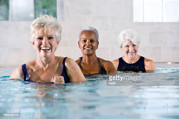 Multiracial senior women at indoor swimming pool and fitness spa