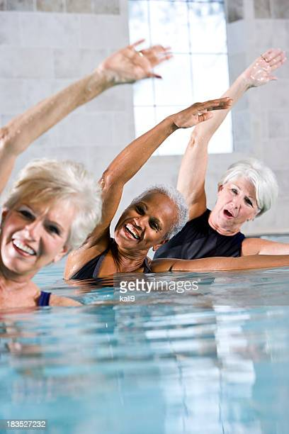 Multiracial senior women in water aerobics class