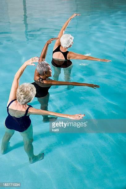 Multiracial senior women in water aerobics class