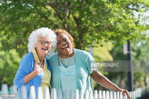 Multiracial senior women standing together outdoors
