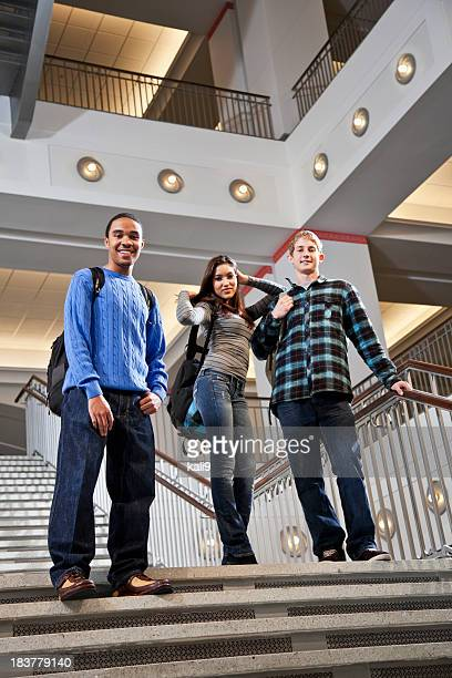 Multiracial university students on steps of school building
