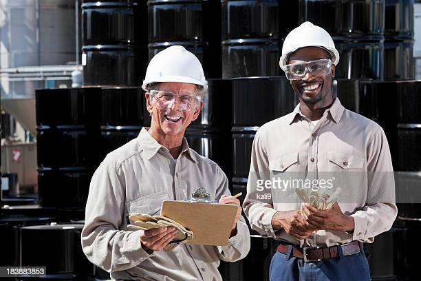 Multiracial workers at chemical plant