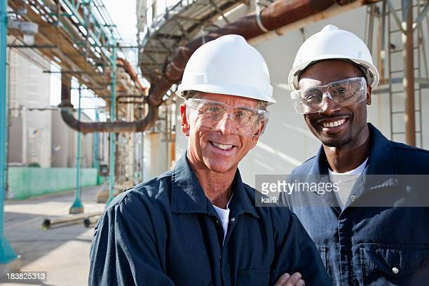 Multiracial workers at industrial plant
