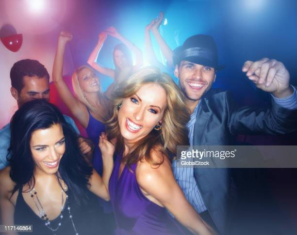 Multiracial young boys and girls enjoying in a nightclub