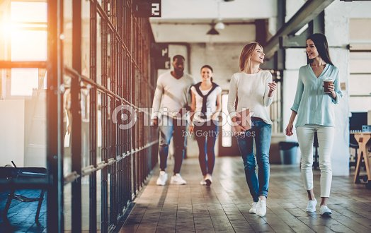 Multiracial young creative people in modern office. : Stock Photo