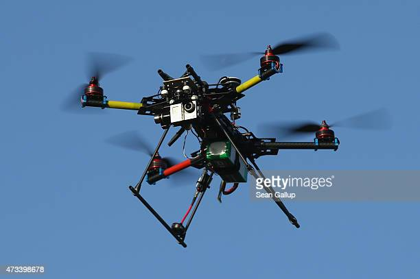A multirotor quadcopter drone used for aerial photography flies on June 7 2011 near Zeestow Germany Many governments in Europe and North America have...