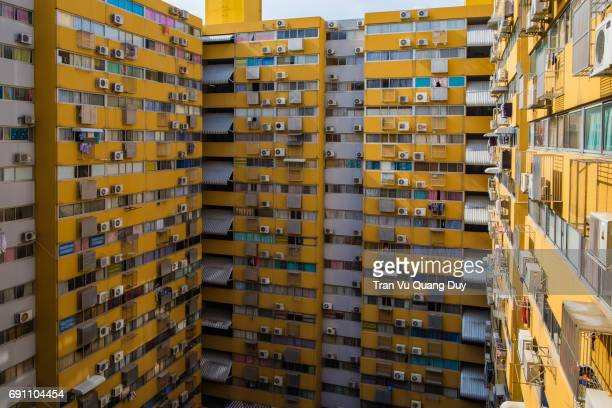 A multi-storey yellow apartment in Thailand.