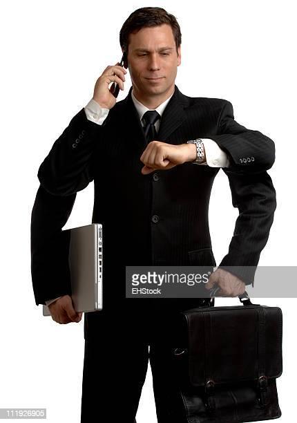マルチ Tasker ビジネスマンが携帯電話ノートパソコンのあるブリーフケース白背景