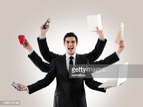 Multi-tasking man : Stock Photo
