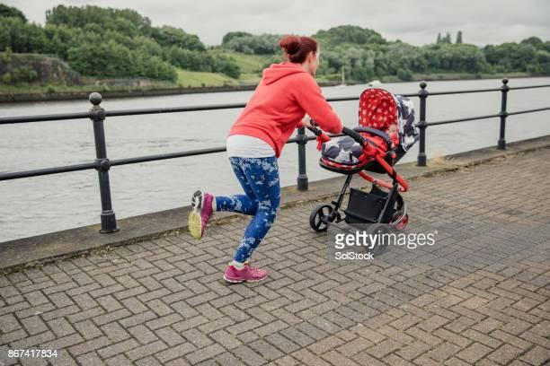 Multitasking Mother Running With Pushcair