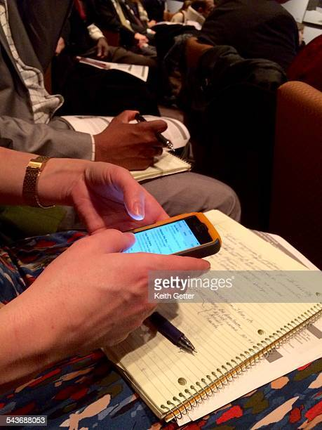 MultiTasking on a cell phone while sitting in at a learning conference