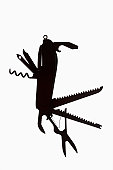 A multi-tool hanging in silhouette