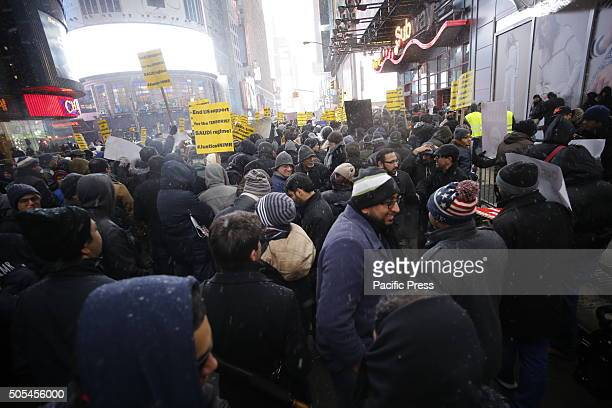 Multitudes huddle under increasing flurries Hundreds of Muslims gathered in Times Square to protest against the Saudi government's execution of...