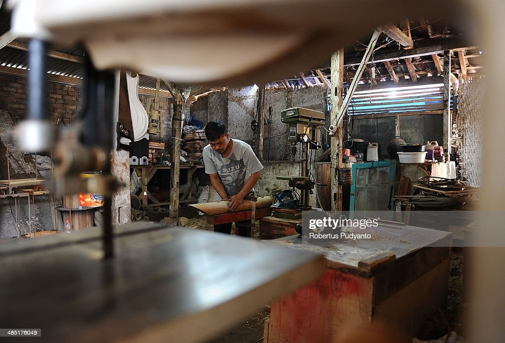Mulyadi, 36, a bamboo artisans works to make a bamboo lute in his workshop at Tanjung Wangi Village on April 17, 2014 in Bandung, Java, Indonesia. Adang Muhidin, founder of Indonesian Bamboo Community, and his friends make sustainable bamboo musical instruments (guitar, violin, bass, trumpet, clarinet, saxophone, drums) a nod to the rise of the creative economy in Indonesia.