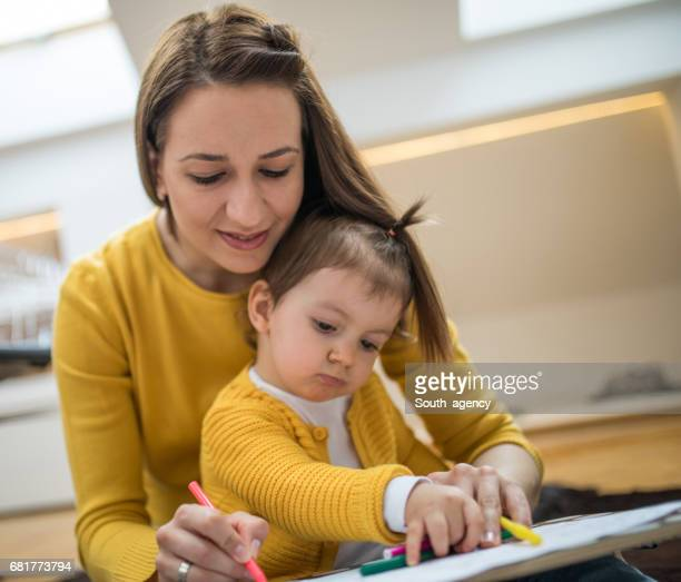 Mum and child drawing