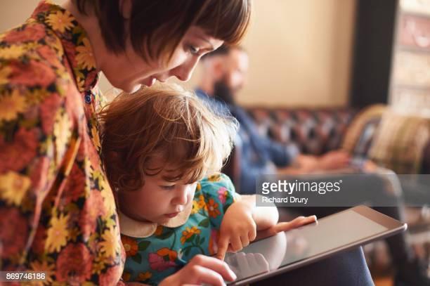 Mum and daughter using digital tablet