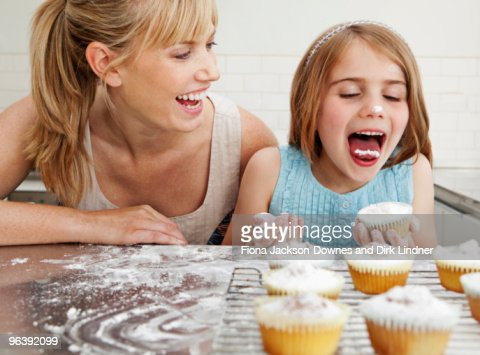 Mum and daughter with cakes : Stock Photo