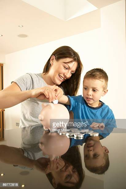 mum and son with money