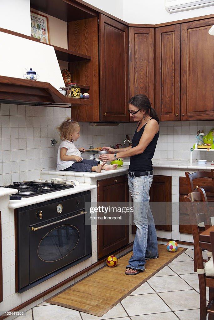 mum, daughter, kitchen, wooden spoon : Stock Photo