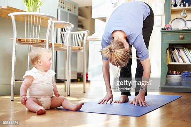 mum doing yoga with a baby