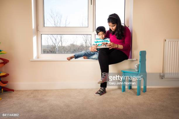 Mum reading story to young son.