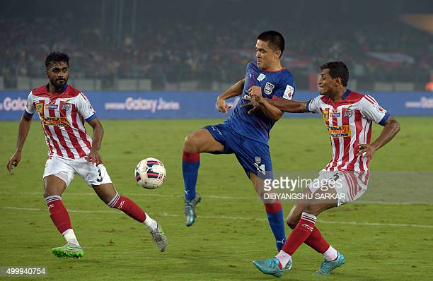 Mumbai City FC forward Sunil Chhetri vies for the ball with AtleticodeKolkata's defender Arnab Mandal during the Indian Super League football match...