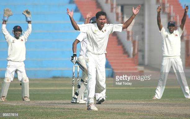 Mumbai Cricket player Ajit Agrkar celebrates after taking a wicket at a Ranji Trophy Super League match between Railway VS Mumbai in New Delhi on...