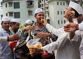 Mumbai Dabbawaalas celebrate the success of Indian Mars Orbiter Mission by exchanging sweets amongst themselves at Lower Parel on September 24 2014...