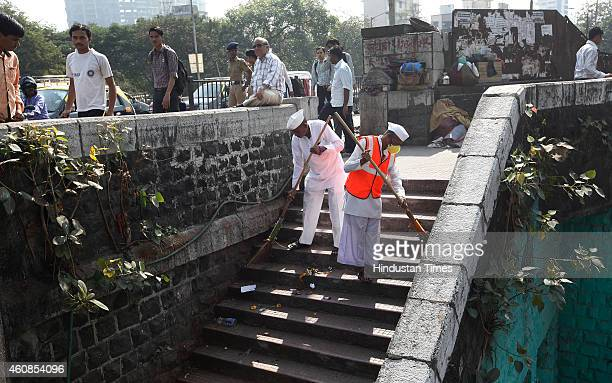 Mumbai Dabbawala participated in Clean India drive by sweeping at Lower Parel after their name was nominated by Prime Minister M Narendra Modi on...