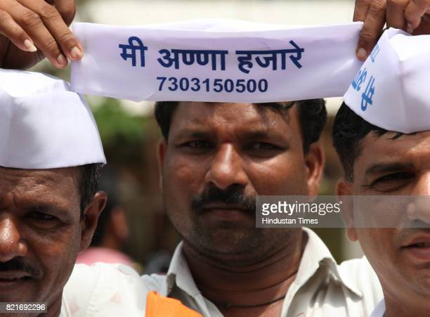 Mumbai Dabbawala Supporter's of Anna Hazare protest at the Azad Maidan against his arrest in Mumbai on Tuesday