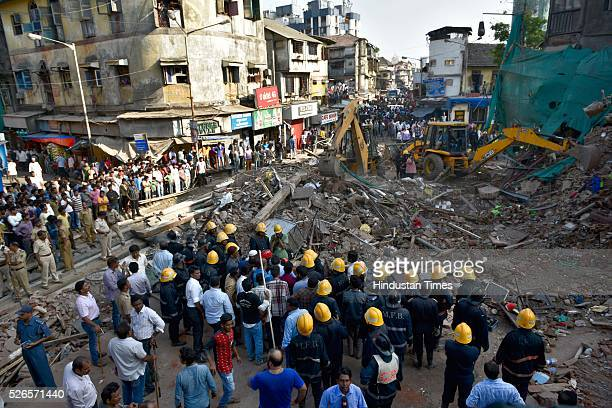 Mumbai Fire Brigade removing the debris after a building collapsed at lane number 14 of Kamathipura on April 30 2016 in Mumbai India At least five...