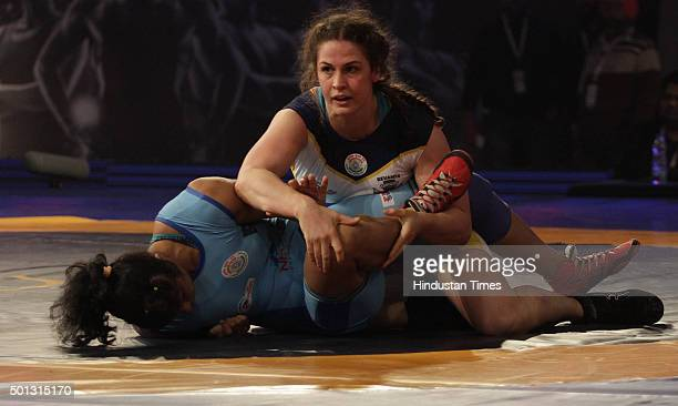 Mumbai Garudas wrestler Adeline Gray grapples with Navjot Kaur of Bengaluru Yodhas in women's 69kg category during the Pro Wrestling League at Guru...