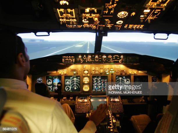 A flying instructor from Indian airline Jet Airways demonstrates a Full Flight Simulator for Boeing 737800 aircraft in Mumbai 22 November 2005 The...