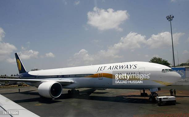 A recently acquired Boeing 777300ER aircraft of India's Jet Airways stands on the tarmac at Chatrapati Shivaji International Airport in Mumbai 13 May...