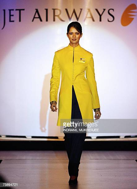 An employee of Jet Airways wears a new uniform during a function to showcase the company's new logo and uniform in Mumbai 16 April 2007 India's...