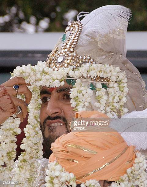Bollywood film actor and groom Abhishek Bachchan dressed in the traditional attire smiles as he rides on a horse outside Prateeksha one of the...