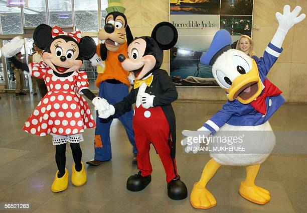 Disney cartoon characters Minnie Mouse Goofy Mickey Mouse and Donald Duck pose during a promotional campaign in Mumbai 04 January 2006 The campaign...