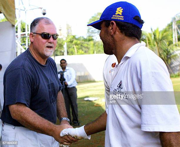 Former England cricket captain Mike Gatting shakes hands with a fellow cricketer after a match between Marylebone Cricket Club and an Afghanistan XI...