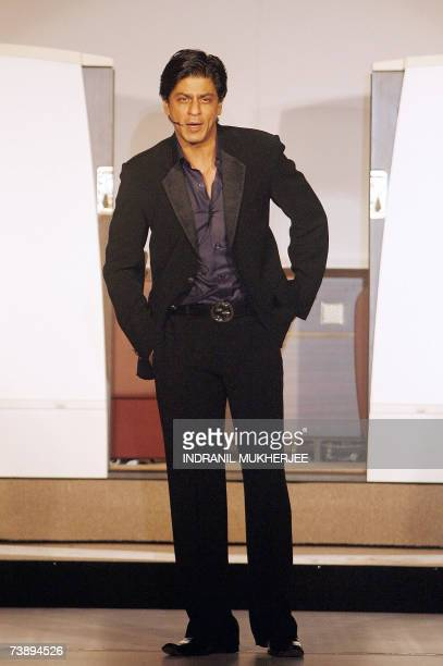 Indian actor Shahrukh Khan speaks during a function to showcase the new Jet Airways logo and uniform in Mumbai 16 April 2007 India's largest private...